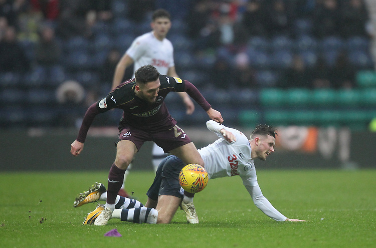 Preston North End's Alan Browne battles with  Swansea City's Matt Grimes<br /> <br /> Photographer Mick Walker/CameraSport<br /> <br /> The EFL Sky Bet Championship - Preston North End v Swansea City - Saturday 12th January 2019 - Deepdale Stadium - Preston<br /> <br /> World Copyright &copy; 2019 CameraSport. All rights reserved. 43 Linden Ave. Countesthorpe. Leicester. England. LE8 5PG - Tel: +44 (0) 116 277 4147 - admin@camerasport.com - www.camerasport.com