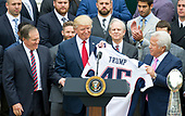 United States President Donald J. Trump, center, and New England Patriots owner Robert Kraft, right, hold up the Super Bowl LI jersey as the President welcomes the Super Bowl Champions to the South Lawn of White House in Washington, DC on Wednesday, April 19, 2917.  At left is Patriots head coach Bill Belichick.<br /> Credit: Ron Sachs / CNP<br /> (RESTRICTION: NO New York or New Jersey Newspapers or newspapers within a 75 mile radius of New York City)