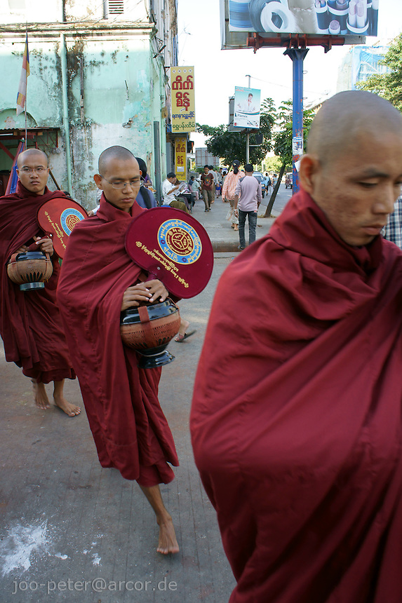 monks in the streets of Yangon, Myanmar, 2011
