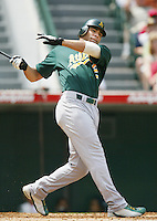 Carlos Pena of the Oakland Athletics bats during a 2002 MLB season game against the Los Angeles Angels at Angel Stadium, in Anaheim, California. (Larry Goren/Four Seam Images)