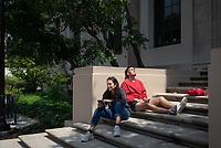 Ella Ezratty '19 and Yolbars Myhre '21 relax from studying for finals on the steps outside the library<br /> Occidental College students study for finals and write papers during finals week in the Academic Commons/Mary Norton Clapp Library, Monday, May 6, 2019.<br /> (Photo by Marc Campos, Occidental College Photographer)