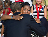 United States President Barack Obama hugs a crowd member during a remembrance ceremony for the 12th anniversary of the 9/11 terrorist attacks, at the Pentagon on September 11, 2013 in Arlington, Virginia. <br /> Credit: Kevin Dietsch / Pool via CNP