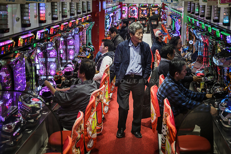 Osaka, Japan, November 25 2016 - A man walks in an alley of a pachinko, a slot game center, usually owned in Japan by Zainichi Koreans.<br /> Osaka&rsquo;s Korea town in Tsuruhashi is the home of the largest Korean community (Zainichi) in Japan.<br /> The majority of Koreans in Japan are Zainichi Koreans, often known simply as Zainichi , who are the permanent ethnic Korean residents of Japan. The term &quot;Zainichi Korean&quot; refers only to long-term Korean residents of Japan who trace their roots to Korea under Japanese rule, distinguishing them from the later wave of Korean migrants who came mostly in the 1980s. The estimated population is about 500,000 people. As of 2016, about 90% of them have South Korean nationality and 10% of them are considered by Japanese administration as &laquo;&nbsp;Korean&nbsp;&raquo; (chosenjin), the word used for korean people before the division between North and South Korea in 1948. The ratio used to be the opposite in the 1950ies.