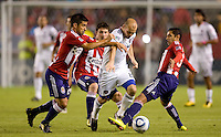 Chicago Fire forward Freddie Ljungberg dribbles through a maze of Chivas USA players Paulo Nagamura (l), Ben Zemanski (c) and Mariano Trujillo (r). The Chicago Fire defeated CD Chivas USA 3-1 at Home Depot Center stadium in Carson, California on Saturday October 23, 2010.