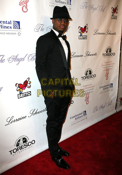 """NE-YO (Shaffer Chimere Smith).Gabrielle's Angel Foundation for cancer research hosts """"Angel Ball 2010"""", New York, NY, USA..October 21st, 2010.full length black tuxedo white hat sunglasses shades .CAP/ADM/PZ.©Paul Zimmerman/AdMedia/Capital Pictures."""