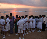 School group on fort ramparts at sunset in historic town of Galle, Sri Lanka, Asia
