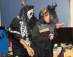 Staff members Liam Duggan and Silla Lernihan entertaining the children at the Clare Champion Halloween Party for Ennis NS and Holy family school children. Photograph by John Kelly.