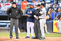 Umpire Nolan Early, Asheville Tourists manager Robinson Cancel, home plate umpire Evin Johnson and Augusta GreenJackets manager Carlos Valderrama (21) meet at home plate before a game against the Augusta GreenJackets at McCormick Field on April 4, 2019 in Asheville, North Carolina. The GreenJackets defeated the Tourists 9-5. (Tony Farlow/Four Seam Images)