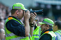 Video surveillance by trained police officers at a UK football match
