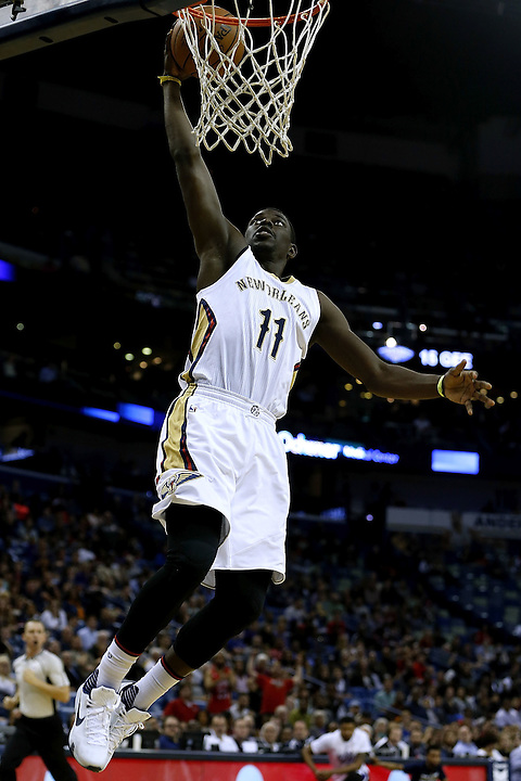 NEW ORLEANS, LA - MARCH 07:  Jrue Holiday #11 of the New Orleans Pelicans scores during the first half of a game against the Sacramento Kings at Smoothie King Center on March 7, 2016 in New Orleans, Louisiana. The Pelicans won 115-112. NOTE TO USER: User expressly acknowledges and agrees that, by downloading and or using this photograph, User is consenting to the terms and conditions of the Getty Images License Agreement.  (Photo by Jonathan Bachman/Getty Images)
