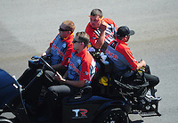 Apr. 14, 2012; Concord, NC, USA: Crew members for NHRA top fuel dragster driver Steve Torrence during qualifying for the Four Wide Nationals at zMax Dragway. Mandatory Credit: Mark J. Rebilas-