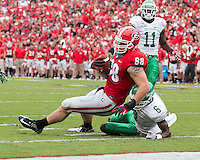 The Georgia Bulldogs played North Texas Mean Green at Sanford Stadium.  After North Texas tied the game at 21 early in the second half, the Georgia Bulldogs went on to score 24 unanswered points to win 45-21.Georgia Bulldogs tight end Arthur Lynch (88) goes over the goal line while being tackled by North Texas Mean Green defensive back Hilbert Jackson (6)