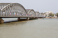 Senegal, Saint Louis.  Pedestrians on the  Pont Faidherbe, Bridge over the River Senegal.  Built 1897.