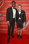Designer Thom Browne receives a Star award and poses with Dwyane Wade professional NBA player, at The Fashion Group International's Night of Stars 2017 gala at Cipriani Wall Street on October 26, 2017.