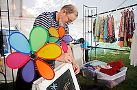 NWA Democrat-Gazette/DAVID GOTTSCHALK  Vern Eckley constructs the entrance Friday, September 4, 2015 in the display area for Raggedy Annie and Company t the 64th annual Clothesline Fair at Fair at Prairie Grove Battlefield State Park. The display will offer custom dresses, scarves and bowes for little girls. The fair opens today and runs through Monday.