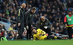 Manchester City Manager Pep Guardiola looks on as Roberto Pereyra of Watford goes down injured during the English Premier League match at The Etihad Stadium, Manchester. Picture date: December 12th, 2016. Photo credit should read: Lynne Cameron/Sportimage