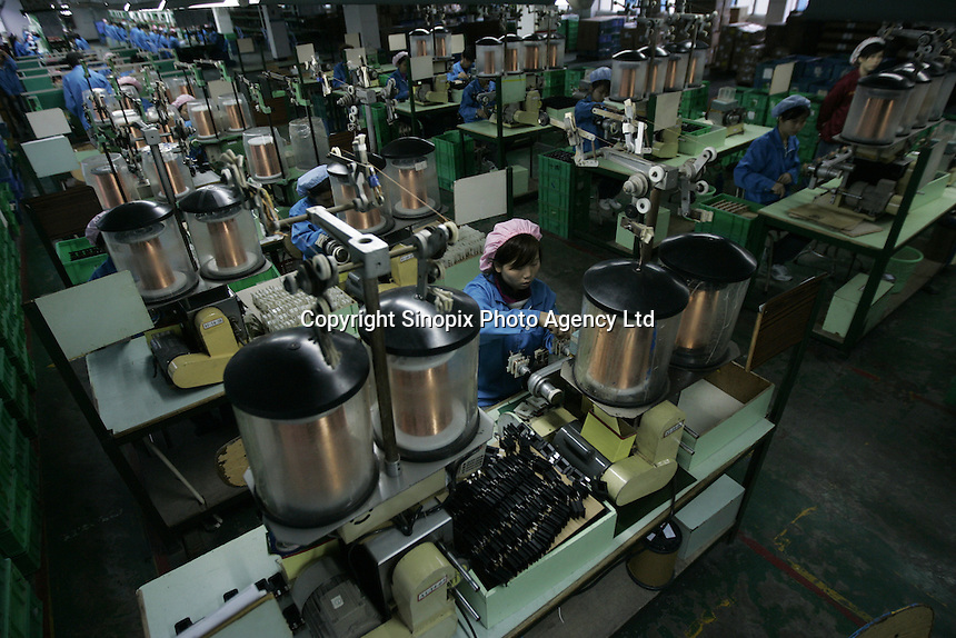 Transformer factory makes mobile phone chargers, laptop chargers in Shenzhen, China. Factories in China cranked up production on signs of improving global demand...