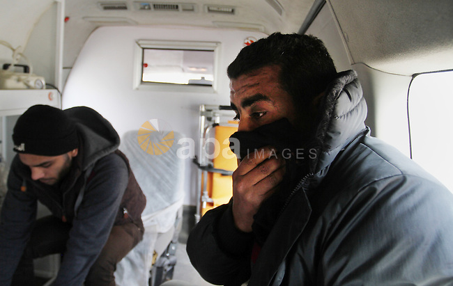 Relatives of Palestinian Ishaq Hassan, 28, who was killed by Egyptian soldiers after swimming into Egyptian waters mourn during the arrival of an ambulance carry his body from the Egyptian side of Rafah border crossing at the southern Gaza Strip, on Dec. 31, 2015. Egyptian authorities opened the tightly controlled Rafah Crossing to let the corpse of the Palestinian man killed by Egyptian soldiers into the Gaza Strip. Hassan's family have said he was attempting to reach Egyptian hospitals in order to receive treatment for a disease that could not be treated in Gaza. Photo by Abed Rahim Khatib