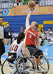 November 19 2011 - Guadalajara, Mexico:   Janet McLachlan of Team Canada reaches for a pass in the Gold Medal Game against Team USA in the CODE Alcalde Sports Complex at the 2011 Parapan American Games in Guadalajara, Mexico.  Photos: Matthew Murnaghan/Canadian Paralympic Committee