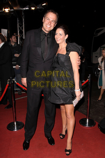 PETER & TARA JONES.The British Academy Film Awards 2010 After Party at the Grosvenor Hotel, London, England..February 21st, 2010.BAFTA BAFTAs full length black dress suit married husband wife.CAP/AH.©Adam Houghton/Capital Pictures.