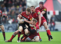 David Strettle is tackled in possession. Aviva Premiership match, between Saracens and London Welsh on March 3, 2013 at Allianz Park in London, England. Photo by: Patrick Khachfe / Onside Images
