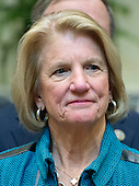 """United States Senator Shelley Moore Capito (Republican of West Virginia) listens as US President Donald J. Trump makes remarks prior to signing H.J. Res. 38, disapproving the rule submitted by the US Department of the Interior known as the Stream Protection Rule in the Roosevelt Room of the White House in Washington, DC on Thursday, February 16, 2017.  The Department of Interior's Stream Protection Rule, which was signed during the final month of the Obama administration, """"addresses the impacts of surface coal mining operations on surface water, groundwater, and the productivity of mining operation sites,"""" according to the Congress.gov summary of the resolution.<br /> Credit: Ron Sachs / Pool via CNP"""