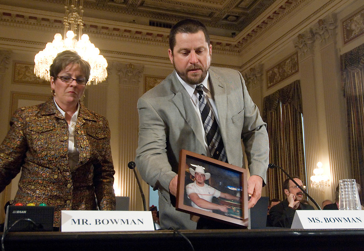 "Mike and Kim Bowman, of Forreston, Illinois,place a photo of their son, Specialist Tim Bowman, U.S. Army, Illinois National Guard, Bravo Troop, 106th Calvary, on the wtiness table as they arrive to testify during the House Veterans Affairs Committee hearing on ""Stopping Suicides: Mental Health Challenges Within the Department of Veterans Affairs (VA),"" on Wednesday, Dec. 12, 2007. Their son shot himself after returning form duty in Iraq."