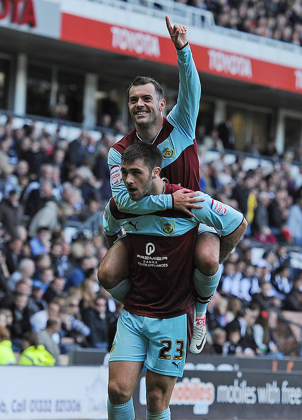 Burnley's Charlie Austin celebrates scoring his and his sides second goal in the last minutes of the match to secure a 2-1 victory with team-mate Ross Wallace ..Football - npower Football League Championship - Derby County v Burnley - Saturday 22nd September 2012 - Pride Park - Derby..
