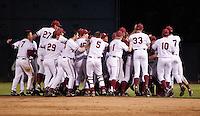 STANFORD, CA - May 10, 2011: The Stanford baseball team celebrates Brett Michael Doran's game winning hit during Stanford's game against Arizona at Sunken Diamond. Stanford won 1-0.