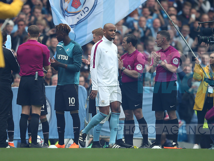 Vincent Kompany of Manchester City leads the team out to a guard of honour during the premier league match at the Etihad Stadium, Manchester. Picture date 22nd April 2018. Picture credit should read: Simon Bellis/Sportimage
