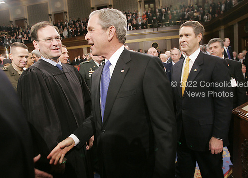 United States President George W. Bush, center, walks past newly appointed Associate Justice of the Supreme Court Samuel A. Alito, Jr., left, as he walks out with US Senate Majority Leader Bill Frist (Republican of Tennessee), right, after delivering the State of the Union address to a joint session of Congress, Wednesday, Jan. 31, 2006 in Washington, DC.<br /> Credit: Pablo Martinez Monsivais / Pool via CNP