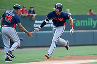 Right fielder Greyson Jenista (23) of the Rome Braves is congratulated by manager Rocket Wheeler after hitting a home run in a game against the Greenville Drive on Wednesday, July 11, 2018, at Fluor Field at the West End in Greenville, South Carolina. He is the Atlanta Braves' 2018 second-round draft pick. (Tom Priddy/Four Seam Images)