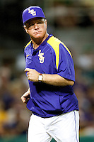 LSU Tigers coach Paul Mineri returns from the pitchers mound during the NCAA baseball game against the Mississippi State Bulldogs on March 17, 2012 at Alex Box Stadium in Baton Rouge, Louisiana. The 10th-ranked LSU Tigers beat #21 Mississippi State, 4-3. (Andrew Woolley / Four Seam Images).