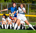 BURLINGTON ,  CT-101519JS15-  Lewis Mills' Alyse Pasqualini (18) clears the ball as she gets hit by Newington's Emily Chojnicki (17) during their game Tuesday at Nassahegan Field in Burlington. <br /> Jim Shannon Republican-American
