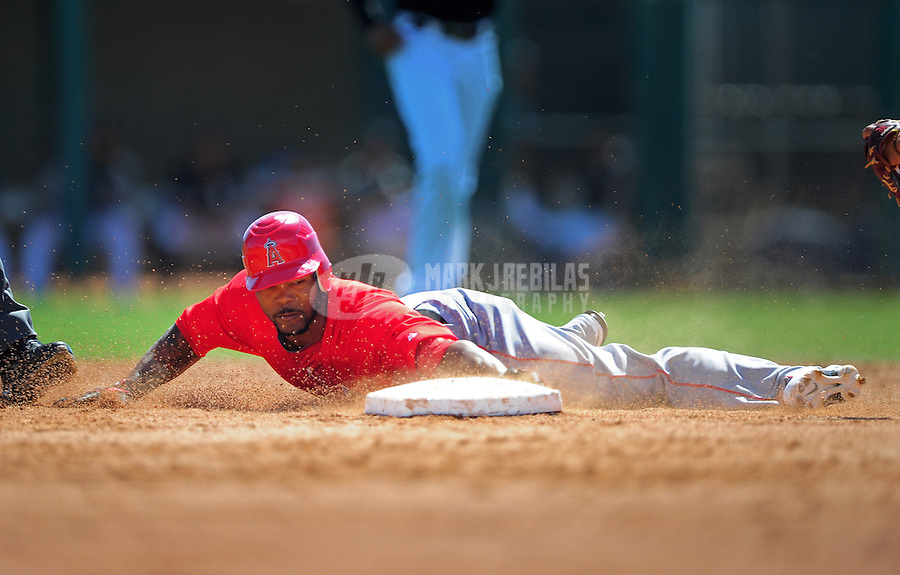 Mar. 14, 2012; Phoenix, AZ, USA; Anaheim Angels base runner Howie Kendrick slides safely into second base in the third inning against the Chicago White Sox at The Ballpark at Camelback Ranch. Mandatory Credit: Mark J. Rebilas-