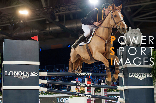 Team magic: Rider Roger-Yves Bost of France and Jockey Joao Moreira of Brazil compete during the Hong Kong Jockey Club Race of the Riders, part of the Longines Masters of Hong Kong on 10 February 2017 at the Asia World Expo in Hong Kong, China. Photo by Marcio Rodrigo Machado / Power Sport Images