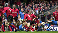 27/03/2004  -  RBS Six Nations Championship 2004 Wales v Italy.Shane Williams looks for a way through, to set up a Welsh attack.   [Mandatory Credit, Peter Spurier/ Intersport Images].