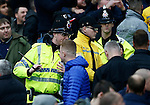 Police draw their battons to keep fans apart during the Barclays Premier League match at The Etihad Stadium. Photo credit should read: Simon Bellis/Sportimage