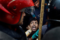 Bangladeshi policemen detained an Urdu spoken Muslim following clashes between two groups at the Geneva camp in a clash in Dhaka, Bangladesh.