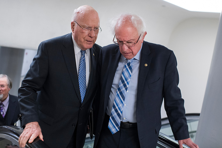 UNITED STATES - JUNE 26: Sens. Patrick Leahy, D-Vt., left, and Bernie Sanders, I-Vt., talk before the Senate Policy luncheons in the Capitol on June 26, 2018. (Photo By Tom Williams/CQ Roll Call)