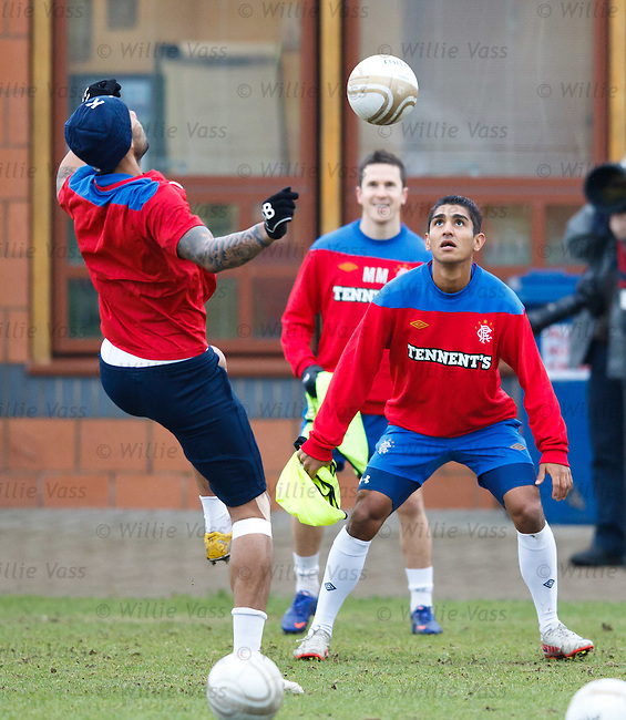 Jorge Claros and Kyle Bartley battling for the ball at training