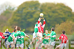 Kevin Breen Killarney Legion and Tim Cronin Rathmore contest the kick out in their AIB Championship relegation play off in Kilcummin on Sunday.
