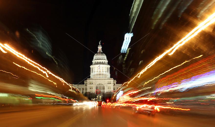 Downtown Building lights leave trails and streaks on Congress Avenue heading to the Texas State Capitol in Austin, Texas, USA.