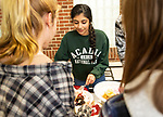 SOUTHBURY,  CT-031419JS08- Meghana Annambhotla, a members of the Mu Alpha Theta Math Honor Society, serves up slices of pie to fellow students during a pie contest held Thursday, Pi day, at Pomperaug High School in Southbury. Students in the club brought in 20 homemade pies and served slices to fellow students. The pies were judged on taste and appearance. This is the first year the club has done this since being formed last year. <br /> Jim Shannon Republican American