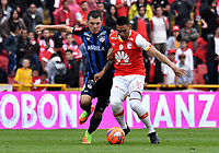 BOGOTA - COLOMBIA - 07 - 05 - 2017: Yeison Gordillo (Der.) jugador de Independiente Santa Fe, disputa el balón con Leonardo Pico (Izq.) jugador de Atletico Junior, durante partido de la fecha 16 entre Independiente Santa Fe y Atletico Junior, por la Liga Aguila I-2017, en el estadio Nemesio Camacho El Campin de la ciudad de Bogota. / Yeison Gordillo (R) player of Independiente Santa Fe struggles for the ball with Leonardo Pico (L) player of Atletico Junior, during a match of the date 16th between Independiente Santa Fe and Atletico Junior, for the Liga Aguila I -2017 at the Nemesio Camacho El Campin Stadium in Bogota city, Photo: VizzorImage / Luis Ramirez / Staff.