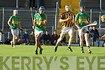 John Buckley (Lixnaw) in action with Niall Quilter (Abbeydorney) in the  Garvey's SuperValu Senior Hurling Championship 2014 Quarter Finals at Austin Stack Park, Tralee on Saturday.