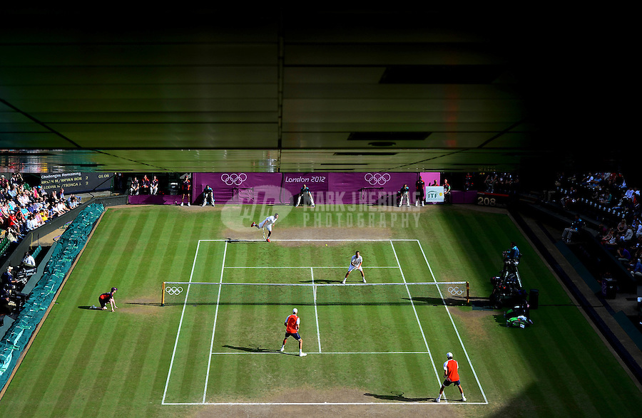 Aug 4, 2012; London, United Kingdom; Overall view of the match between Mike Bryan and Bob Bryan (USA) against Michael Llodra and Jo-Wilfried Tsonga (FRA) during the men's doubles gold medal match during London 2012 Olympic Games at Wimbledon. Mandatory Credit: Mark J. Rebilas-USA TODAY Sports