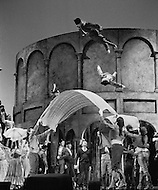 "April 1968, Manhattan, New York City, New York State, USA. Actors are tossed up into the air using blankets in a scene from Jean-Louis Barrault's ""Carmen Noire"". It is being performed in New York's Metropolitan Opera House. Image by © JP Laffont"