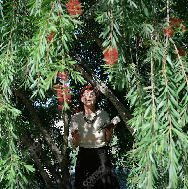 Mrs. Ruckim prays in her backyard, Gush Katif, Gaza, July 2005.