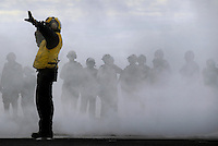 071027-N-7981E-260 PACIFIC OCEAN (October 27, 2007)- An aircraft director positions an aircraft on one of Nimitz-class aircraft carrier USS Abraham Lincoln's steam-powered catapults during flight operations on the ship's flight deck. Lincoln and embarked Carrier Air Wing (CVW) 2 are underway off the coast of Southern Calif. participating in Composite Training Unit Exercise (COMPTUEX), an exercise aimed at enhancing the interoperability between Lincoln and its Strike Group. U.S. Navy photo by Mass Communication Specialist 3rd Class James R. Evans (RELEASED)